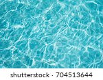 water in swimming pool rippled... | Shutterstock . vector #704513644