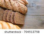 mixed frash baked bread on... | Shutterstock . vector #704513758