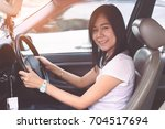 beautiful woman driving a car... | Shutterstock . vector #704517694