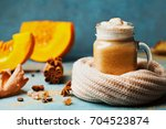 pumpkin spiced latte or coffee... | Shutterstock . vector #704523874
