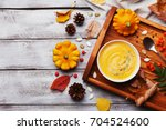 wooden tray with hot autumn... | Shutterstock . vector #704524600