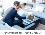 smart handsome businessman... | Shutterstock . vector #704527810