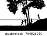 children silhouette in nature . | Shutterstock .eps vector #704528050