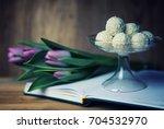 reading book with tea flower... | Shutterstock . vector #704532970