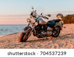motorcycle chopper against the... | Shutterstock . vector #704537239