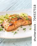 honey lime salmon on the plate | Shutterstock . vector #704537518