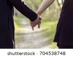 close up of a couple holding... | Shutterstock . vector #704538748