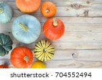 pumpkins and squashes on wooden ... | Shutterstock . vector #704552494