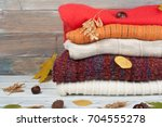knitted wool sweaters. pile of... | Shutterstock . vector #704555278