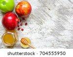 honey  apple and pomegranate... | Shutterstock . vector #704555950