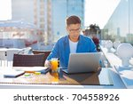young freelancer working on... | Shutterstock . vector #704558926