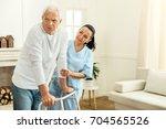 pleasant professional caregiver ... | Shutterstock . vector #704565526