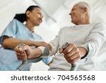 selective focus of walking...   Shutterstock . vector #704565568