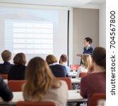 female speaker giving... | Shutterstock . vector #704567800