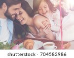 cheerful vibrant family... | Shutterstock . vector #704582986