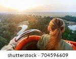little girl enjoying early... | Shutterstock . vector #704596609