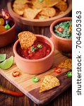 mexican tortilla chips with...   Shutterstock . vector #704605363