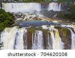 Small photo of Most abounding in water Iguazu Falls in the world. Border of Argentina, Brazil and Paraguay. Concept of active and extreme tourism