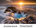 pools of paradise during sunset ... | Shutterstock . vector #704620600