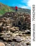 giant's causeway with a blue... | Shutterstock . vector #704624083