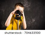 Young Photographer With Camera...
