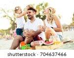 happy family is enjoying beach...   Shutterstock . vector #704637466