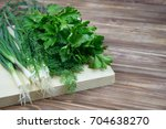 parsley  dill  onion on a... | Shutterstock . vector #704638270