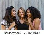 three beautiful young women... | Shutterstock . vector #704644030