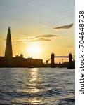 a sunset view of tower bridge... | Shutterstock . vector #704648758