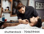 back view of hairstylist in... | Shutterstock . vector #704659444