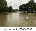 Small photo of Hurricane Harvey 2017, flooding in Spring Texas, a couple miles north of Houston. Speed limit sign almost completely submerged.