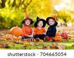 children in black and orange...   Shutterstock . vector #704665054