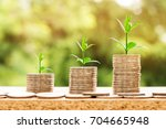 step of coins stacks with tree...   Shutterstock . vector #704665948