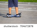 the boy is riding an old...   Shutterstock . vector #704672878