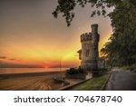 sunrise at appley tower | Shutterstock . vector #704678740