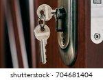 keys in the door lock. object... | Shutterstock . vector #704681404