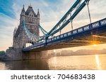 tower bridge with sun flare | Shutterstock . vector #704683438