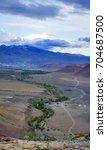 valley of the kyzyl chin stream.... | Shutterstock . vector #704687500