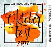 willkommen zum oktoberfest ... | Shutterstock .eps vector #704687944