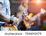 guitarist playing live concert... | Shutterstock . vector #704693479