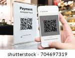 qr code payment   online... | Shutterstock . vector #704697319