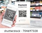 qr code payment   online... | Shutterstock . vector #704697328