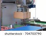 handling packages at automated... | Shutterstock . vector #704703790