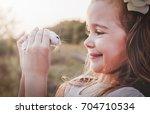 Stock photo cute smiling girl holding white hamster retro look 704710534