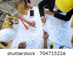engineer people meeting working and pointing at a drawings in office for discussing. Engineering tools and construction concept.