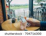 man hand using smart phone... | Shutterstock . vector #704716300