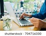 hipster man hands holding a... | Shutterstock . vector #704716330