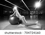 seductive blonde woman  dressed ...   Shutterstock . vector #704724160