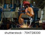 robot welding is welding... | Shutterstock . vector #704728330