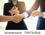 business partnership meeting... | Shutterstock . vector #704731816